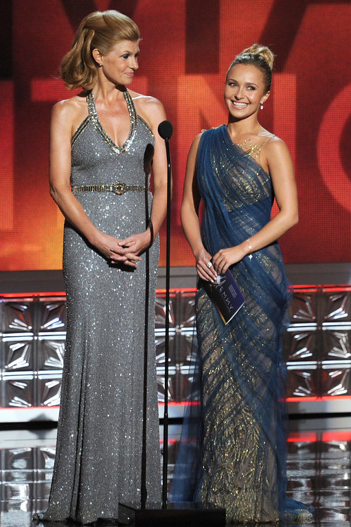 . Actresses Connie Britton (L) and Hayden Panettiere speak onstage during the 64th Annual Primetime Emmy Awards at Nokia Theatre L.A. Live on September 23, 2012 in Los Angeles, California.  (Photo by Kevin Winter/Getty Images)
