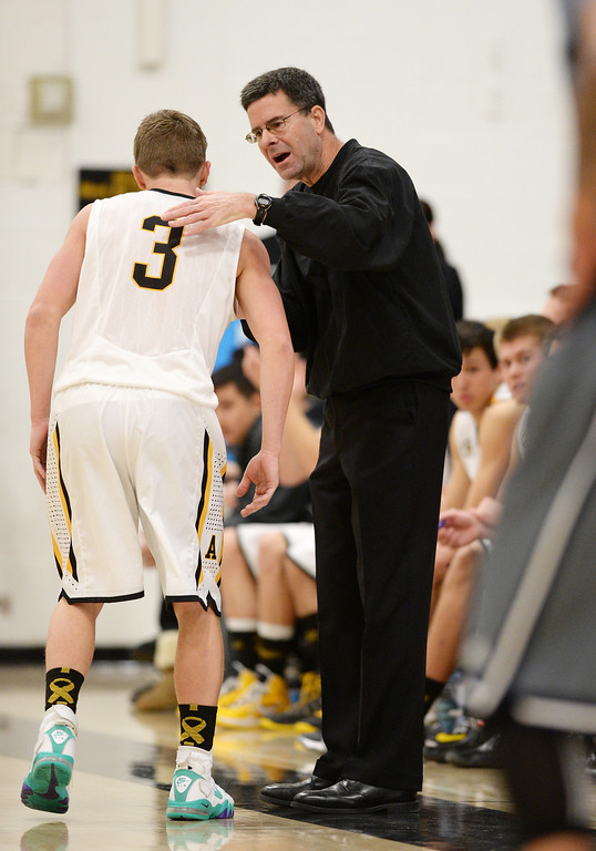 . CENTENNIAL, CO. JANUARY 18: Head coach Dan Snyder talks to Nick Farmen of Arapahoe High School (3) during the 2nd half of the game against Overland High School at Arapahoe High School. Centennial Colorado. January 18. 2014. Arapahoe won 62-54.  (Photo by Hyoung Chang/The Denver Post)