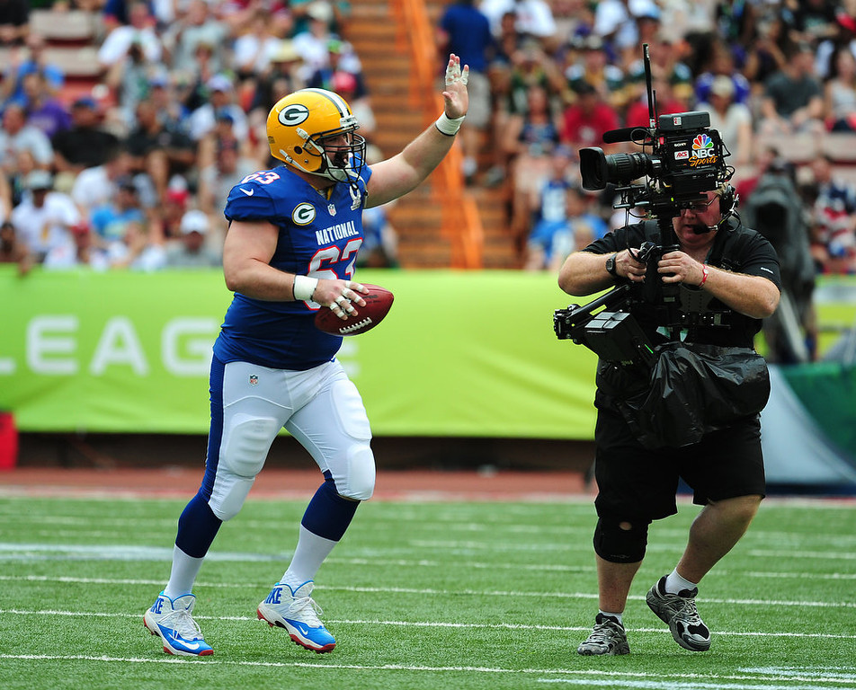 . Jeff Saturday #63 of the Green Bay Packers heads off the field after a play with the AFC team against the National Football Conference team during the 2013 Pro Bowl at Aloha Stadium on January 27, 2013 in Honolulu, Hawaii  Saturday will retire from the NFL after the Pro Bowl. (Photo by Scott Cunningham/Getty Images)