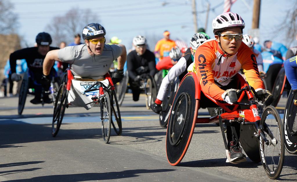 . Participants in the wheelchair division of the 118th Boston Marathon start their race Monday, April 21, 2014 in Hopkinton, Mass. (AP Photo/Stephan Savoia)