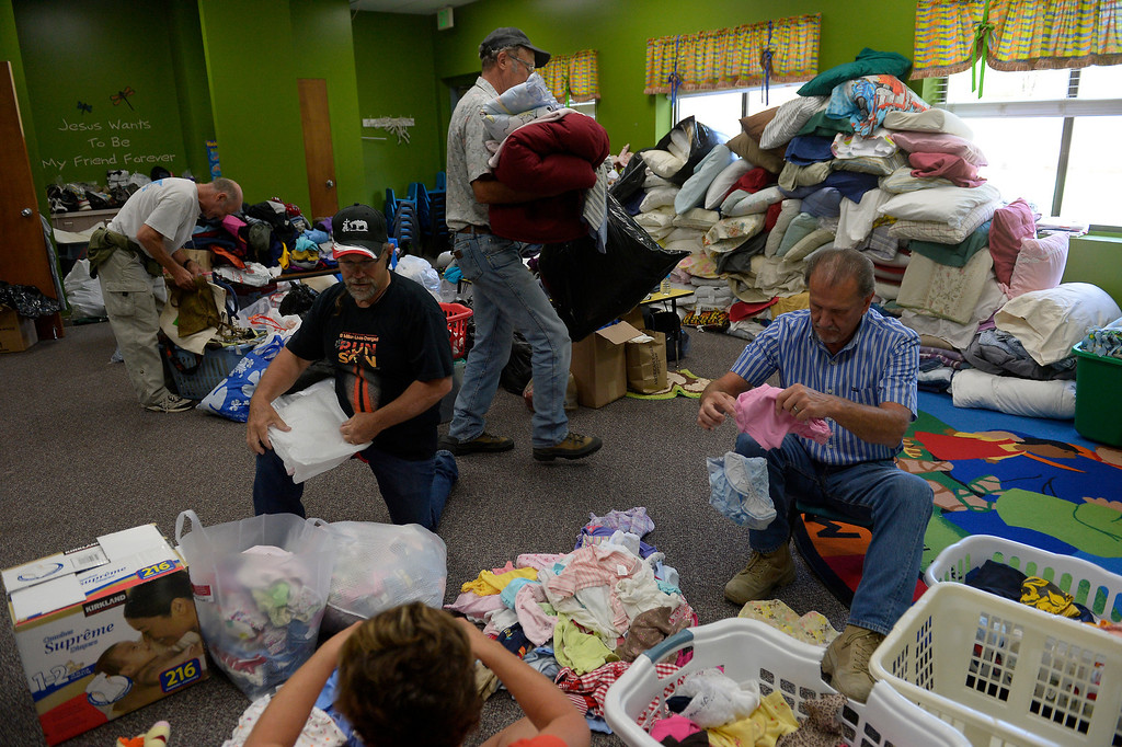 . Volunteer\'s  helping stock donations for rescued residents of Lyons being sheltered at the LifeBridge Christian Church in Longmont September 13, 2013 Longmont, Colorado. (Photo By Joe Amon/The Denver Post)