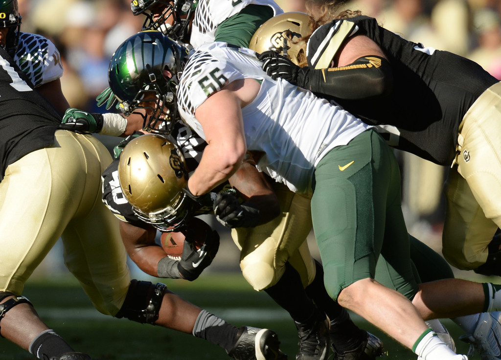 . Taylor Hart of University of Oregon (66) tackles Christian Powell of University of Colorado (46) in the 1st quarter at Folsom Field. Boulder, Colorado. October 5, 2013. (Photo by Hyoung Chang/The Denver Post)