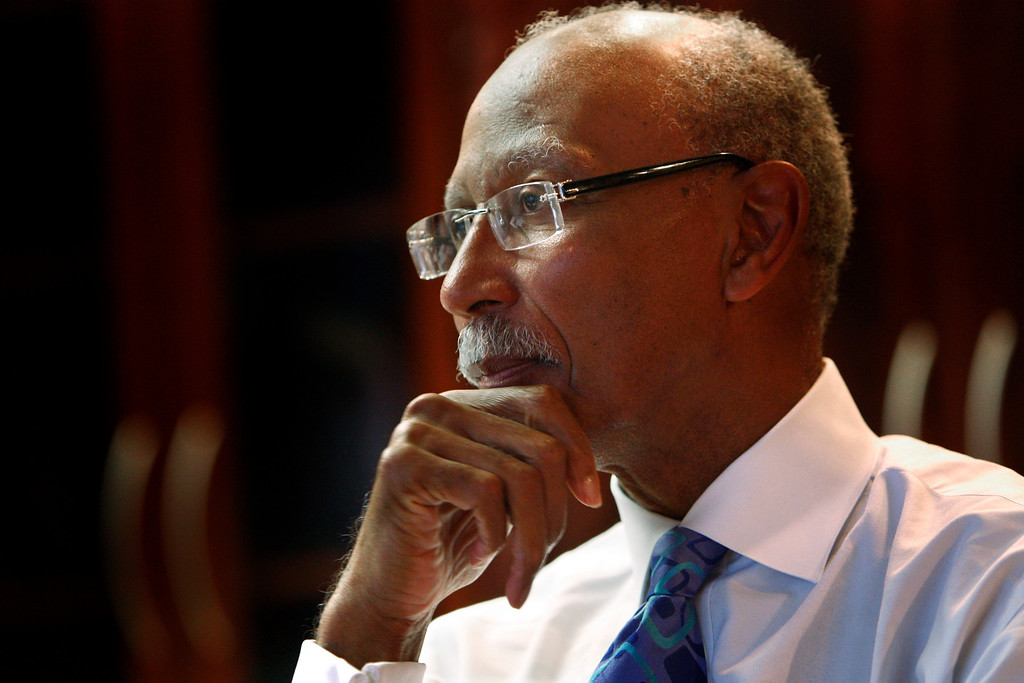 ". Detroit Mayor Dave Bing is seen during an interview in his office, Tuesday, Nov. 24, 2009. Bing\'s vision for Detroit over the next four years includes a leaner, less populated city perhaps dotted with urban farms. But Bing tells The Associated Press that the city has to avoid bankruptcy and still is in ""free-fall\"" due, in part, to a disastrous economy. (AP Photo/Carlos Osorio)"