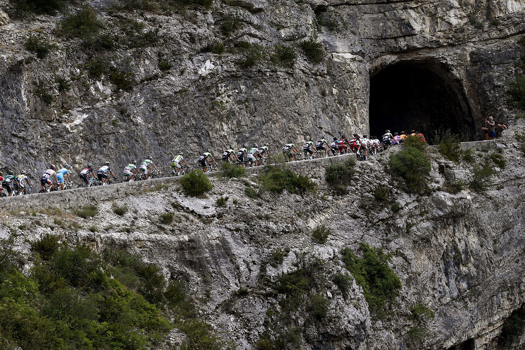 . The pack rides during the 168 km sixteenth stage of the 100th edition of the Tour de France cycling race on July 16, 2013 between Vaison-la-Romaine and Gap, southeastern France.    JOEL SAGET/AFP/Getty Images