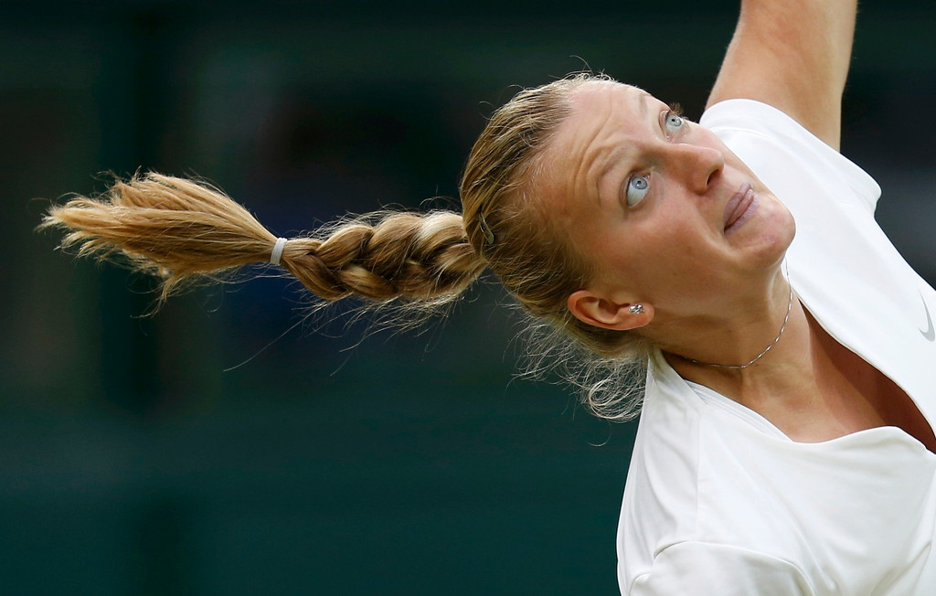 . Petra Kvitova of the Czech Republic serves to Kirsten Flipkens of Belgium during their women\'s quarter-final tennis match at the Wimbledon Tennis Championships, in London July 2, 2013. REUTERS/Suzanne Plunkett
