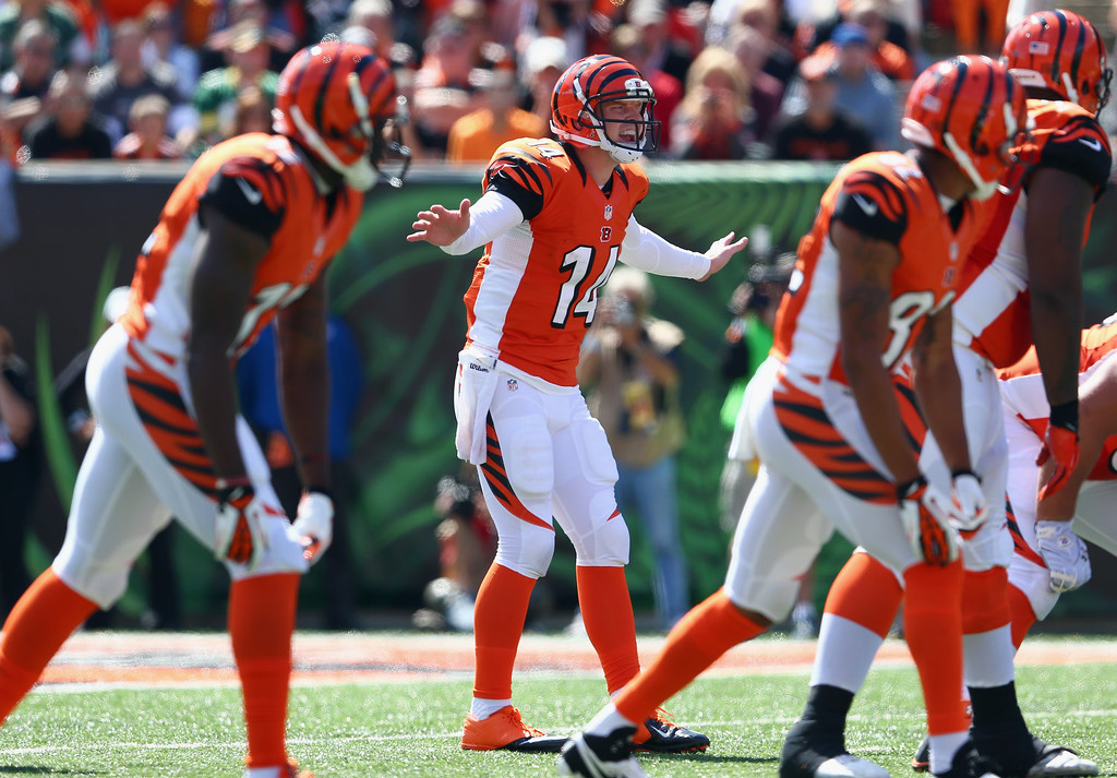 . Andy Dalton #14 of the Cincinnati Bengals gives instructions to his team during the NFL game against the Green Bay Packers at Paul Brown Stadium on September 22, 2013 in Cincinnati, Ohio.  (Photo by Andy Lyons/Getty Images)