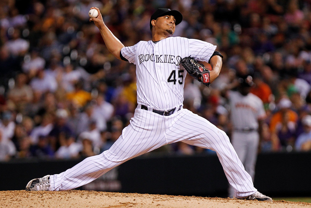 . Colorado Rockies starting pitcher Jhoulys Chacin throws against San Francisco Giants\' Brandon Crawford during the seventh inning of a baseball game, Wednesday, Aug. 28, 2013, in Denver.Crawford broke Chacin\'s no-hitter with a single in the at-bat. (AP Photo/Barry Gutierrez)