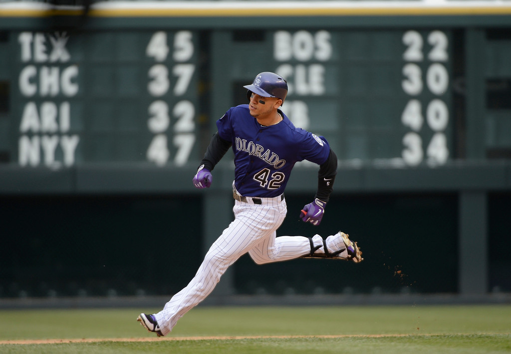 . Carlos Gonzalez of the Colorado Rockies rounds second base on his way to third for a triple in the first inning against the New York Mets April 16, 2013 at Coors Field. Both teams wore the number 42 on their jersey in honor of Jackie Robinson. (Photo By John Leyba/The Denver Post)