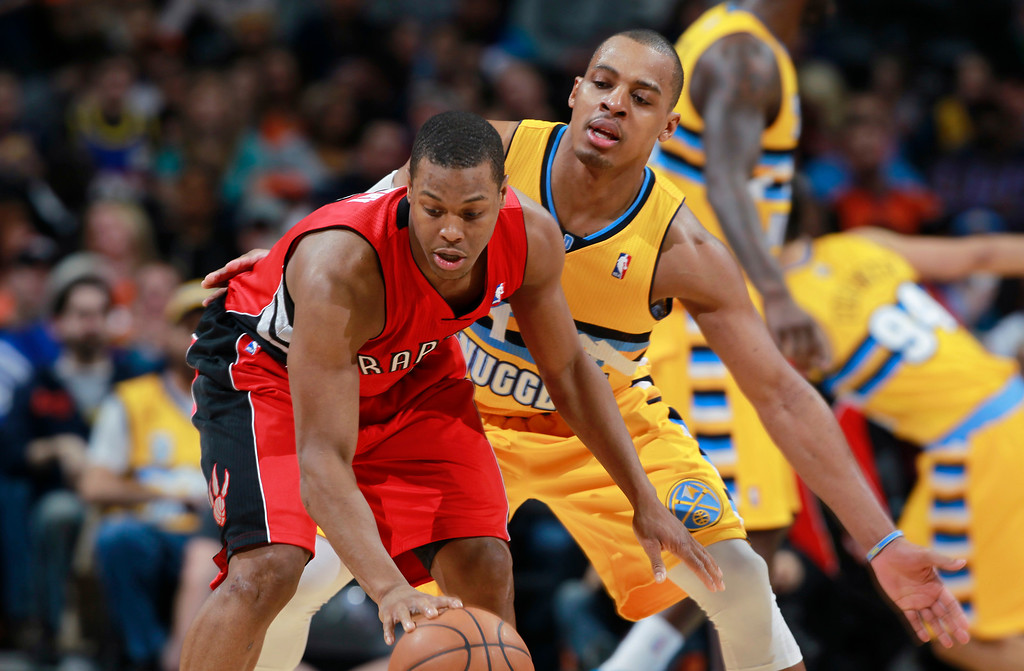 . Toronto Raptors guard Kyle Lowry, front, picks up loose ball as Denver Nuggets guard Randy Foye covers in the third quarter of the Raptors\' 100-90 victory in an NBA basketball game in Denver, Friday, Jan. 31, 2014. (AP Photo/David Zalubowski)