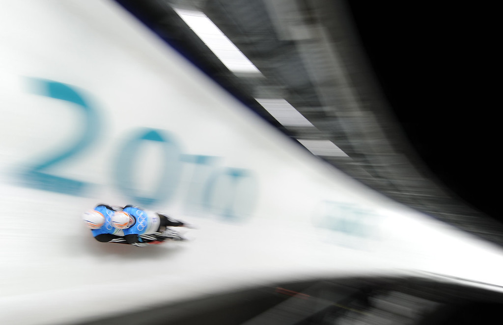 . Andris (top) and Juris Sics of Latvia take part in the men\'s Luge doubles training session at the Whistler sliding centre on February 14, 2010, during the Vancouver Winter Olympics. AFP PHOTO DDP/ OLIVER LANG