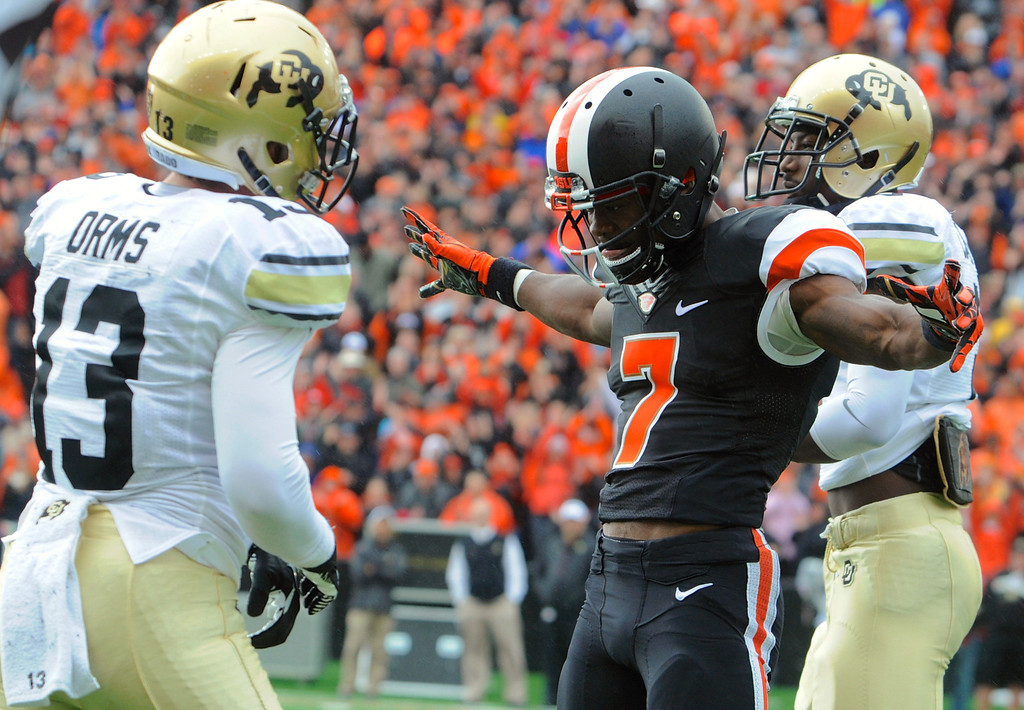 . Oregon State\'s Brandin Cooks (7) celebrates his catch against Colorado\'s Kenneth Crawley (2) and Parker Orms (13) in the first half of an NCAA college football game on Saturday, Sept 28, 2013, in Corvallis, Ore. (AP Photo/Greg Wahl-Stephens)