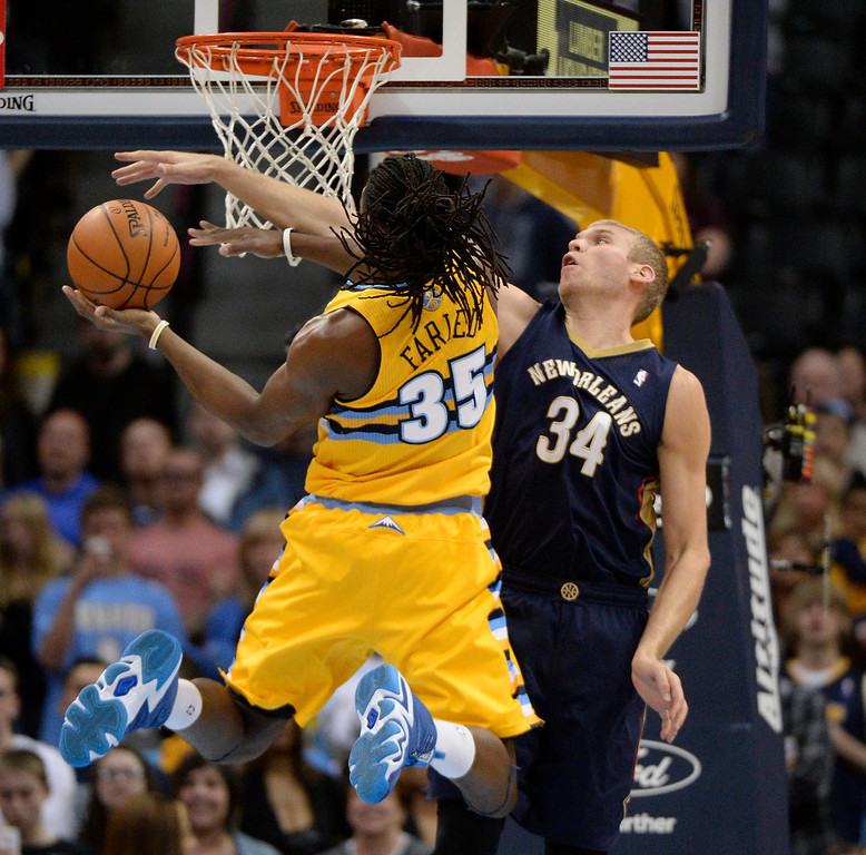 . Denver Nuggets forward Kenneth Faried (35) goes up for a tough shot on New Orleans Pelicans center Greg Stiemsma (34) during the first quarter April 2, 2014 at the Pepsi Center in Denver. (Photo by John Leyba/The Denver Post)