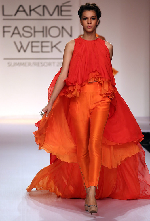 . A model presents a creation by Indian designer Suman Nathwani during the Lakme Fashion Week Summer/Resort 2014 in Mumbai, India, 13 March 2014. Some 92 designers will be showcasing their collections during the event running from 12 to 16 March.  EPA/DIVYAKANT SOLANKI