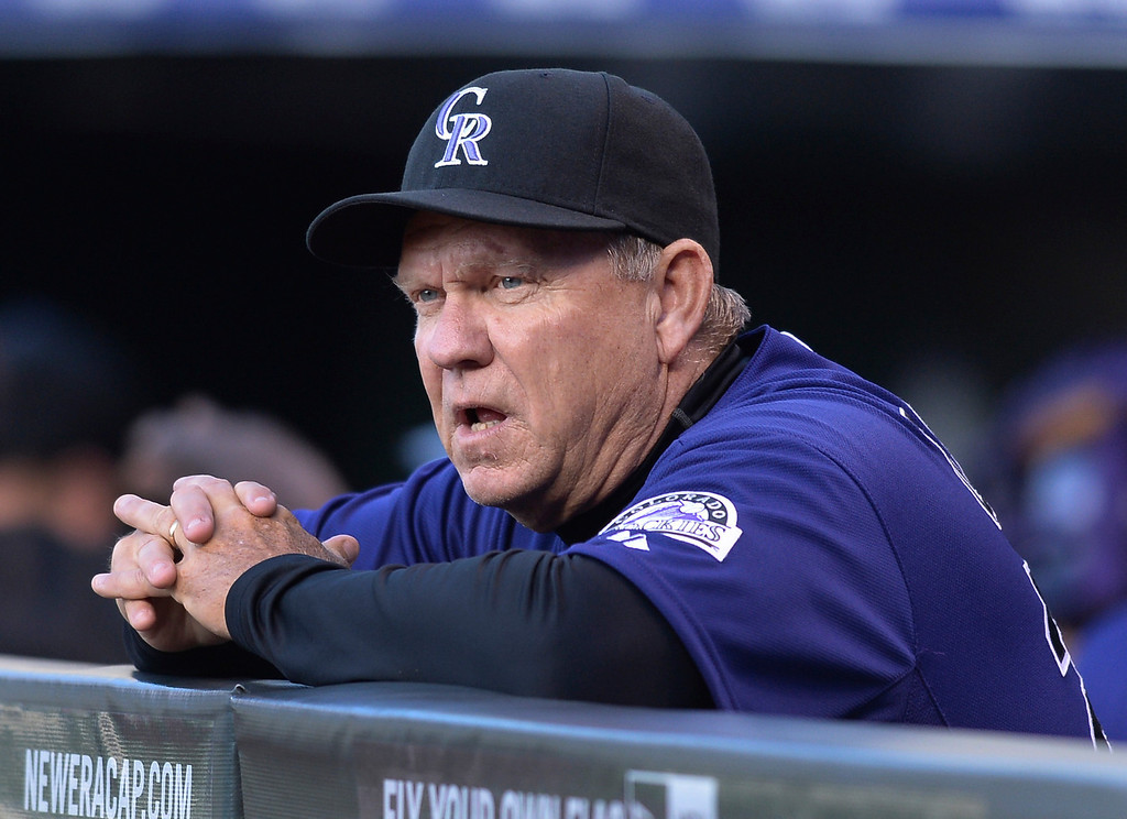 . Colorado pitching coach Blake Doyle watched from the dugout Tuesday. The Chicago White Sox clobbered the Colorado Rockies 15-3 Tuesday night, April 8, 2014 at Coors Field in Denver.  (Photo by Karl Gehring/The Denver Post)