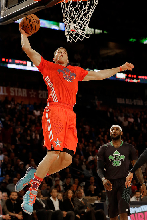 . West Team\'s Blake Griffin, of the Los Angeles Clippers (32) heads to the hoop as East Team\'s LeBron James, of the Miami Heat (6) looks on during the NBA All Star basketball game, Sunday, Feb. 16, 2014, in New Orleans. (AP Photo/Gerald Herbert)