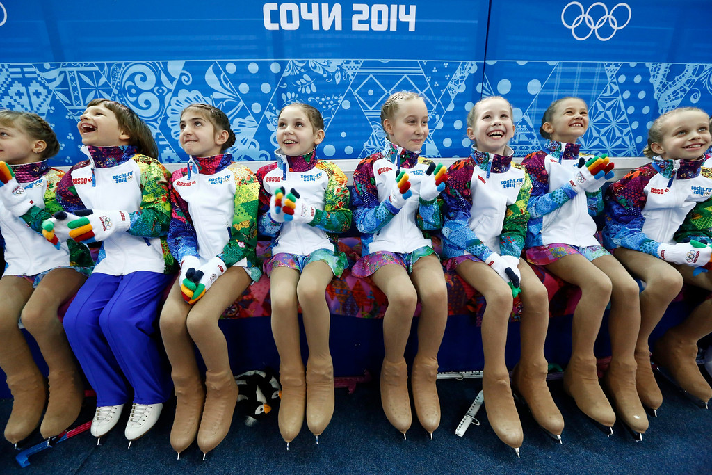 Description of . Flower girls before the Pairs Short Program of the Figure Skating event at Iceberg Palace during the Sochi 2014 Olympic Games, Sochi, Russia, 11 February 2014.  EPA/BARBARA WALTON