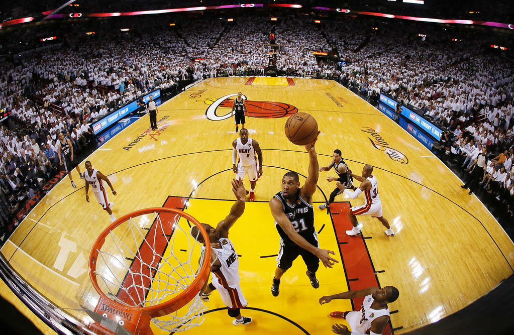 . San Antonio Spurs power forward Tim Duncan (21), shoots against the Miami Heat during the second half of Game 6 in the NBA Finals basketball game,  Wednesday, June 19, 2013 in Miami. The Miami Heat won 103-100 in overtime. (AP Photo/Kevin C. Cox, Pool)