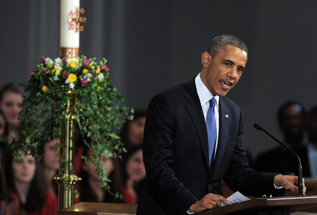 ". US President Barack Obama speaks during ""Healing Our City: An Interfaith Service\"" dedicated to those who were gravely wounded or killed in the Boston Marathon bombing, at the Cathedral of the Holy Cross in Boston, Massachusetts, on April 18, 2013. AFP PHOTO/Jewel  SAMAD/AFP/Getty Images"