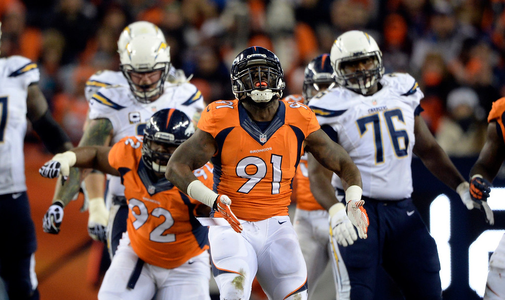 . DENVER, CO - DECEMBER 12: Denver Broncos defensive end Robert Ayers (91) celebrates taking down San Diego Chargers running back Danny Woodhead (39)  during the first half.  The Denver Broncos vs. the San Diego Chargers at Sports Authority Field at Mile High in Denver on December 12, 2013. (Photo by Hyoung Chang/The Denver Post)