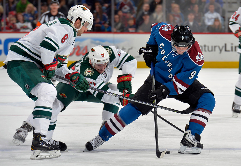 . Colorado Avalanche center Matt Duchene (9) skates against Minnesota Wild center Torrey Mitchell (17) and Marco Scandella (6) during the first period of an NHL hockey game on Saturday, Nov. 30, 2013, in Denver. (AP Photo/Jack Dempsey)