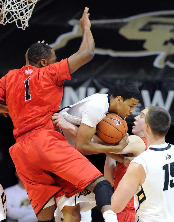 . Andre Roberson of CU, takes in a rebound in front of Wes Cole of Hartford, during the first half of the December 29, 2012 game in Boulder. (Cliff Grassmick / Daily Camera) December 29, 2012