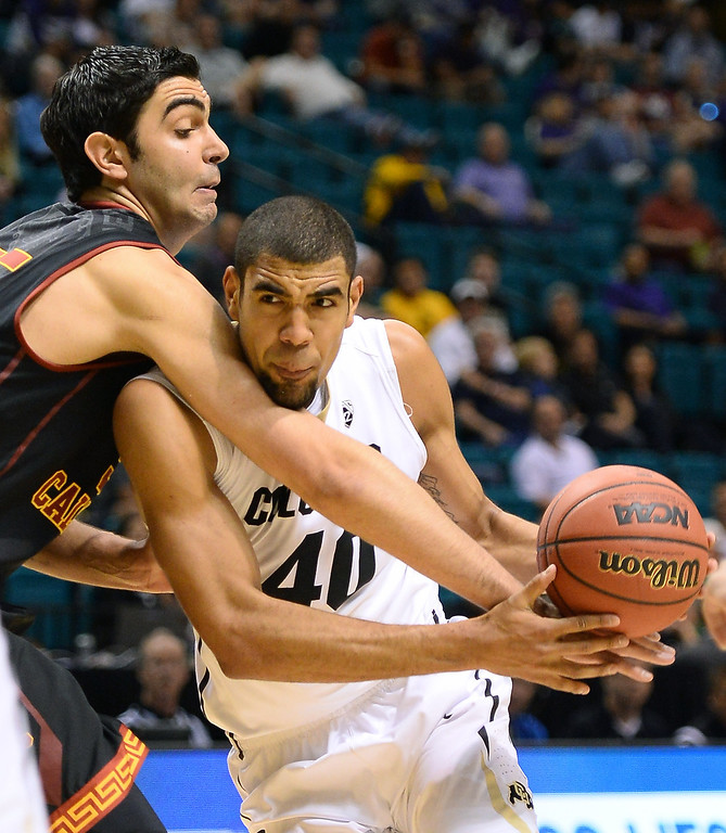 . Josh Scott #40 of the Colorado Buffaloes is fouled by Omar Oraby #55 of the USC Trojans during a first-round game of the Pac-12 Basketball Tournament at the MGM Grand Garden Arena on March 12, 2014 in Las Vegas, Nevada.  (Photo by Ethan Miller/Getty Images)