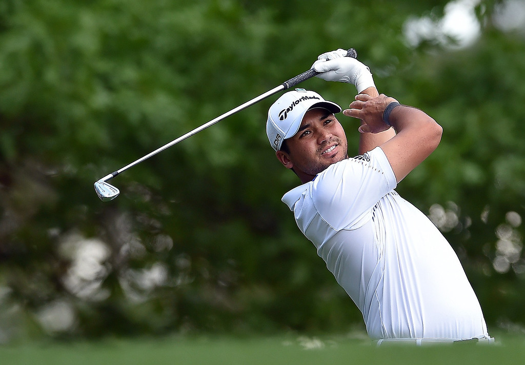 . Jason Day of Australia tees off on the fourth hole during the final round of the 78th Masters Golf Tournament at Augusta National Golf Club on April 13, 2014 in Augusta, Georgia.   EMMANUEL DUNAND/AFP/Getty Images