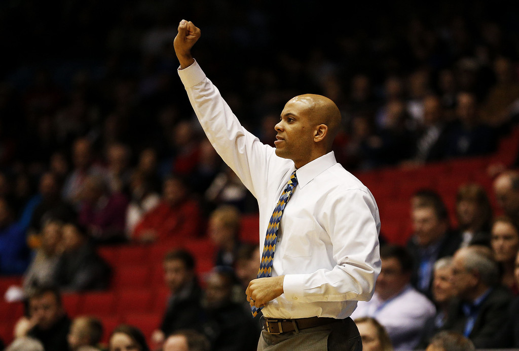 . Head coach Jamion Christian of the Mount St. Mary\'s Mountaineers reacts in the first half against the Albany Great Danes during the first round of the 2014 NCAA Men\'s Basketball Tournament at at University of Dayton Arena on March 18, 2014 in Dayton, Ohio.  (Photo by Gregory Shamus/Getty Images)