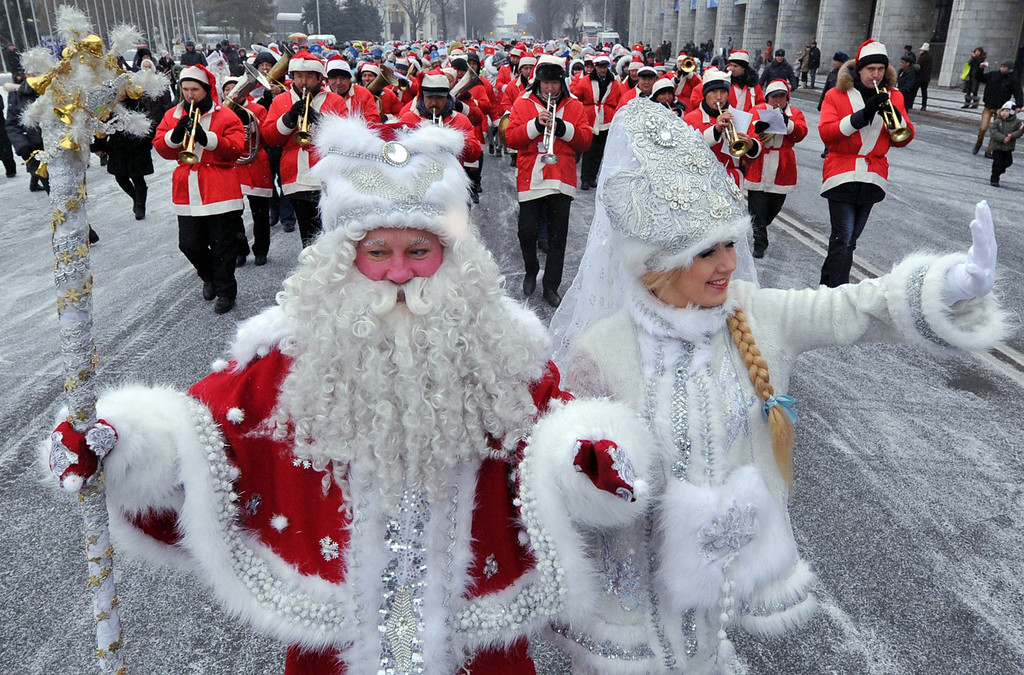 . Actors dressed as the Russian Ded Moroz (Grandfather Frost) (L) and his companion Snegurochka (Snow Maiden) (R) take part a New Year parade in the Kyrgyzstan\'s capital Bishkek on December 31, 2013. New Year, which was the biggest informal holiday of the year in the former Soviet Union, is also very popular in predominantly Muslim Central Asian nation of Kyrgyzstan.  VYACHESLAV OSELEDKO/AFP/Getty Images