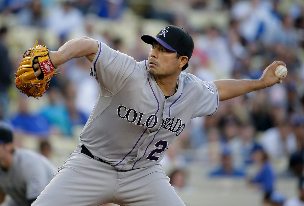 . Colorado Rockies starting pitcher Jorge De La Rosa throws against the Los Angeles Dodgers during first inning of a baseball game in Los Angeles, Wednesday, June 18, 2014. (AP Photo/Chris Carlson)