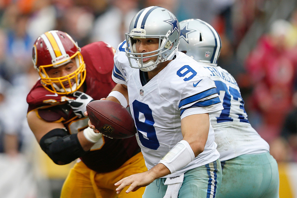 . Dallas Cowboys quarterback Tony Romo scrambles out of the pocket during the second half of an NFL football game against the Washington Redskins in Landover, Md., Sunday, Dec. 22, 2013. (AP Photo/Evan Vucci)