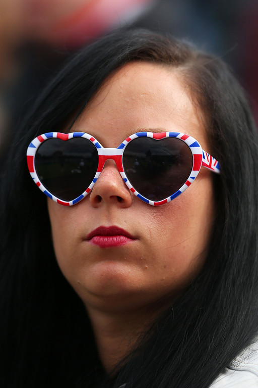 . A spectator wearing Union Jack sunglasses looks on during day one of the Wimbledon Lawn Tennis Championships at the All England Lawn Tennis and Croquet Club on June 24, 2013 in London, England.  (Photo by Julian Finney/Getty Images)