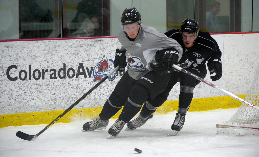 . Colorado Avalanche Gabriel Desjardins (49) and Michael Clarke (63) skate for the puck during rookie camp September 8, 2013 at Family Sports. (Photo by John Leyba/The Denver Post)