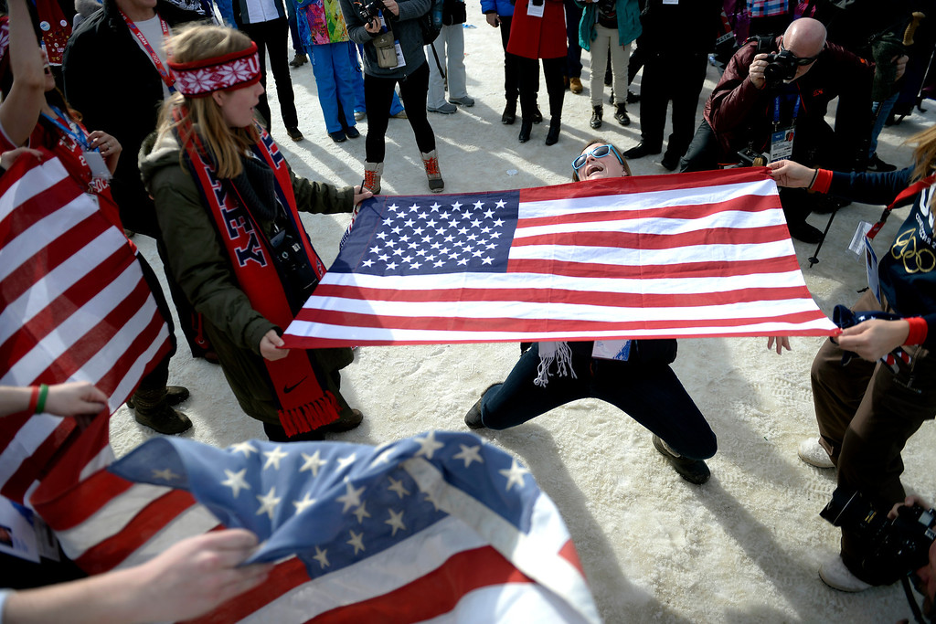 . Americans celebrate a gold-medal performance by their own Jamie Anderson after she won the women\'s snowboard slopestyle final. Sochi 2014 Winter Olympics at the Rosa Khutor Etreme Park on Sunday, February 9, 2014. (Photo by AAron Ontiveroz/The Denver Post)