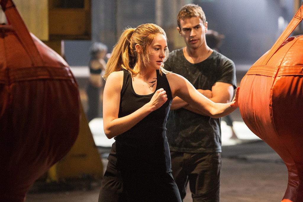 ". This photo released by Summit Entertainment, LLC shows Shailene Woodley as Beatrice ""Tris\"" Prior, left, and Theo James as Four, in the film, \""Divergent.\"" (AP Photo/Summit Entertainment, Jaap Buitendijk)"