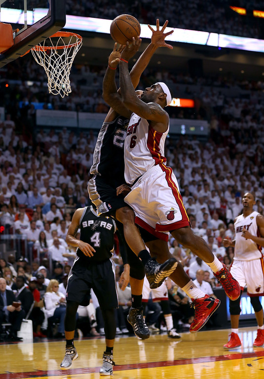 . LeBron James #6 of the Miami Heat goes up for a shot against Tim Duncan #21 of the San Antonio Spurs in the first quarter during Game One of the 2013 NBA Finals at AmericanAirlines Arena on June 6, 2013 in Miami, Florida. (Photo by Mike Ehrmann/Getty Images)