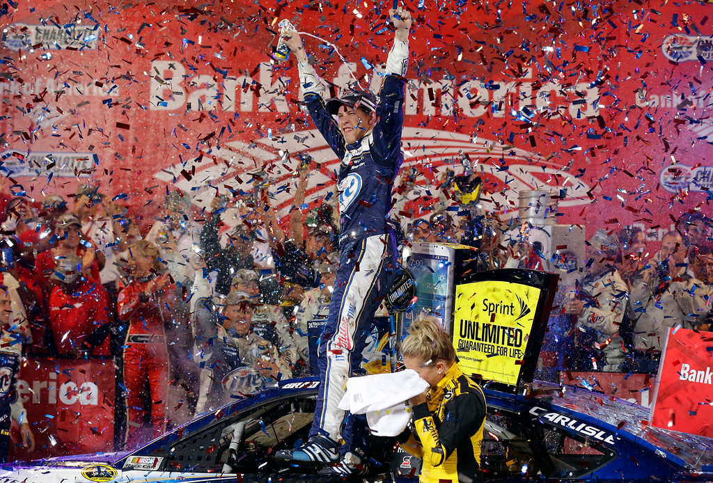 . Brad Keselowski celebrates in Victory Lane after winning the NASCAR Sprint Cup Series auto race at Charlotte Motor Speedway in Concord, N.C., Saturday, Oct. 12, 2013. (AP Photo/Gerry Broome)
