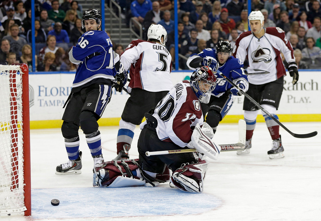 . Colorado Avalanche goalie Sami Aittokallio (30), of Finland, can only watch as a shot by Tampa Bay Lightning defenseman Mark Barberio, not shown, trickles into the goal during the second period of an NHL hockey game Saturday, Jan. 25, 2014, in Tampa, Fla. (AP Photo/Chris O\'Meara)