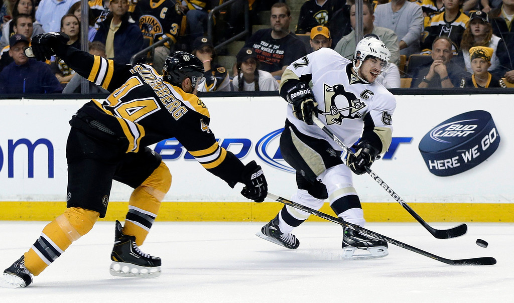 . Pittsburgh Penguins center Sidney Crosby (87) shoots against Boston Bruins defenseman Dennis Seidenberg (44) during the first period of Game 4 in the Eastern Conference finals of the NHL hockey Stanley Cup playoffs, in Boston on Friday, June 7, 2013. (AP Photo/Elise Amendola)