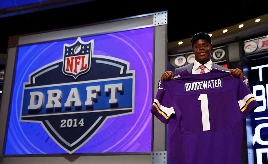 . Teddy Bridgewater of the Louisville Cardinals poses with a jersey after he was picked #32 overall by the Minnesota Vikings during the first round of the 2014 NFL Draft at Radio City Music Hall on May 8, 2014 in New York City.  (Photo by Elsa/Getty Images)