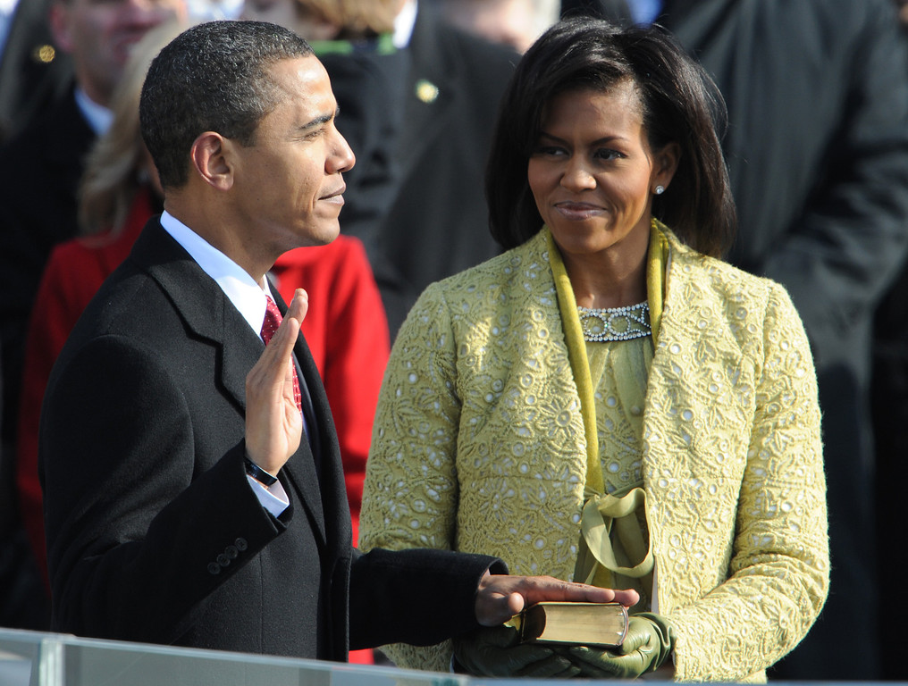 . Barack Obama is sworn in as the 44th US president as his wife Michelle Obama holds the Lincoln Bible at the US Capitol in Washington, DC on January 20, 2009.   PAUL J. RICHARDS/AFP/Getty Images