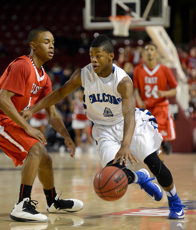 . DENVER, CO. - FEBRUARY 09: Jalen Kittrell (4) of Highlands Ranch drives on Kedryck Kelly (4) of East February 9, 2012 at Magness Arena.  East defeated Highlands Ranch 73 - 54. (Photo By John Leyba/The Denver Post)