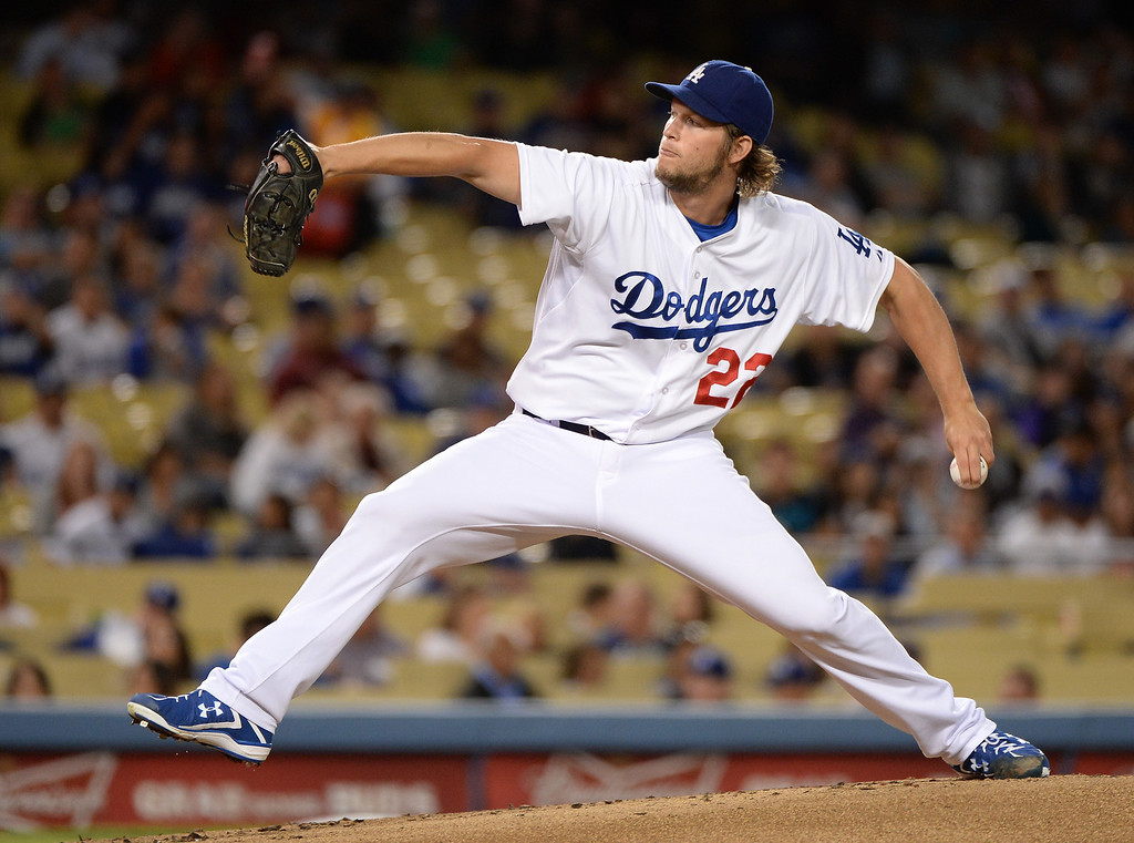. LOS ANGELES, CA - SEPTEMBER 27:  Clayton Kershaw #22 of the Los Angeles Dodgers pitches against the Colorado Rockies during the first inning at Dodger Stadium on September 27, 2013 in Los Angeles, California.  (Photo by Harry How/Getty Images)