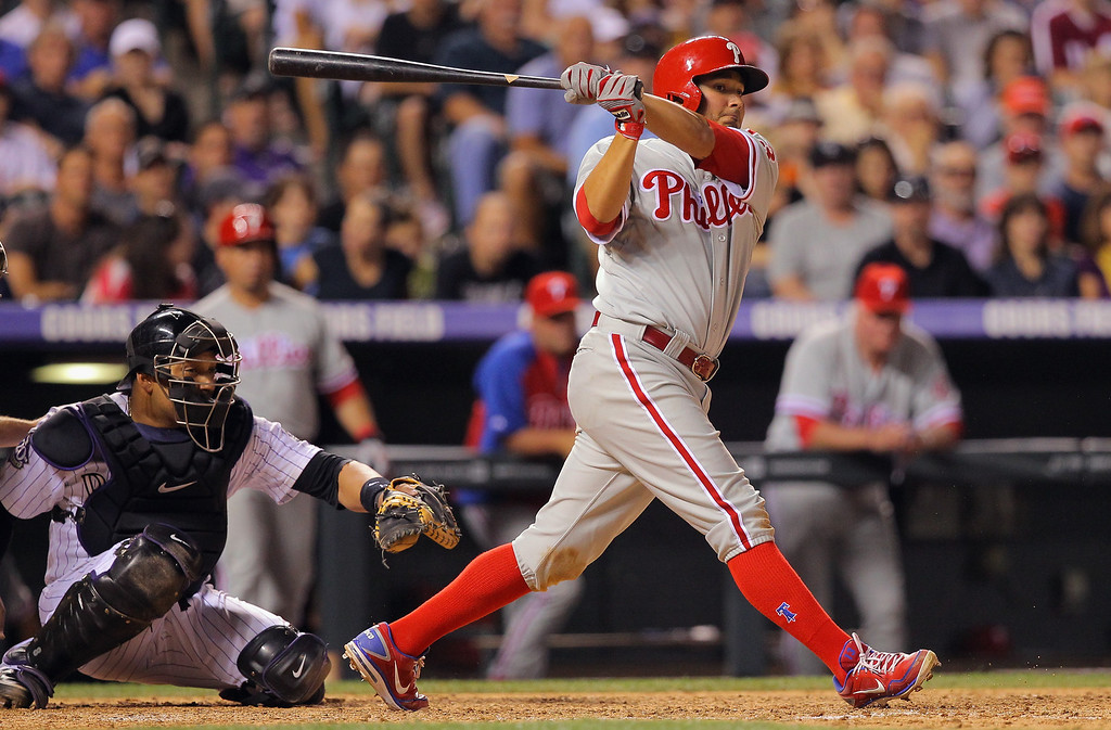 . DENVER, CO - JUNE 14:  Freddy Galvis #13 of the Philadelphia Phillies hits a two RBI triple off of Wilton Lopez #59 of the Colorado Rockies to tie the score 7-7 in the seventh inning at Coors Field on June 14, 2013 in Denver, Colorado.  (Photo by Doug Pensinger/Getty Images)