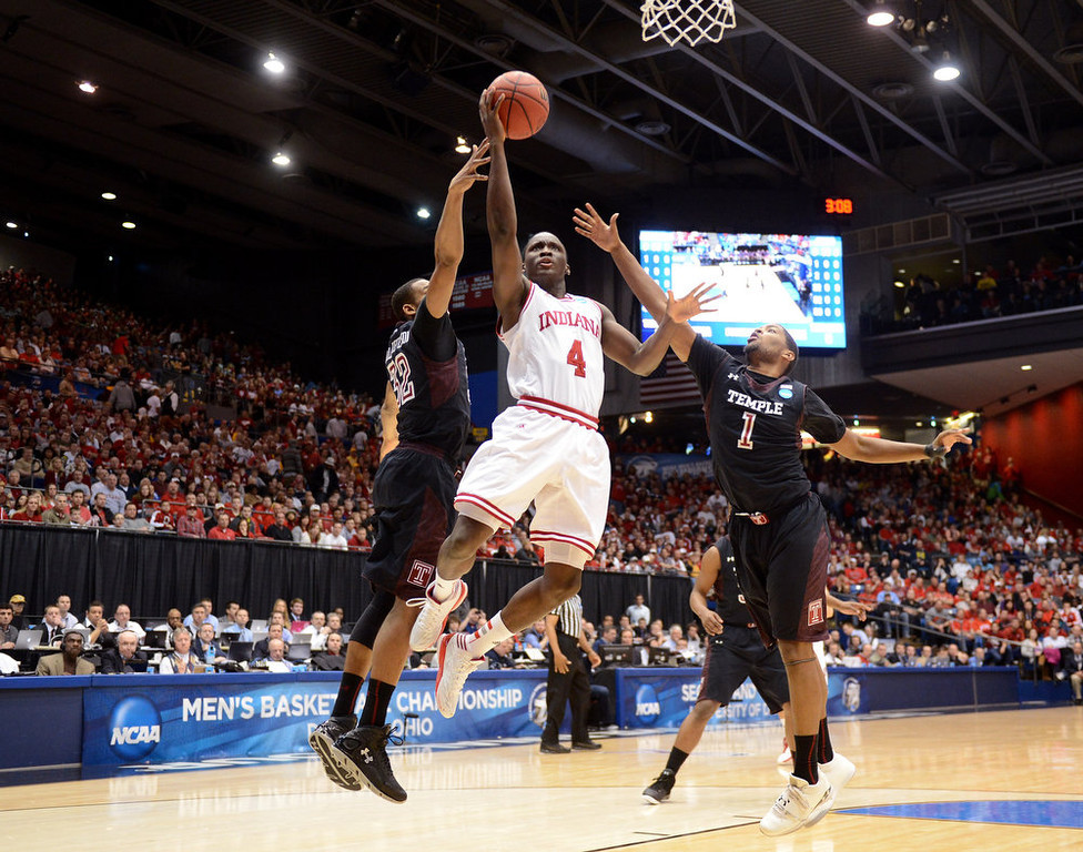 . Victor Oladipo #4 of the Indiana Hoosiers drives to the basket against Rahlir Hollis-Jefferson #32 and Khalif Wyatt #1 of the Temple Owls in the first half during the third round of the 2013 NCAA Men\'s Basketball Tournament at UD Arena on March 24, 2013 in Dayton, Ohio.  (Photo by Jason Miller/Getty Images)