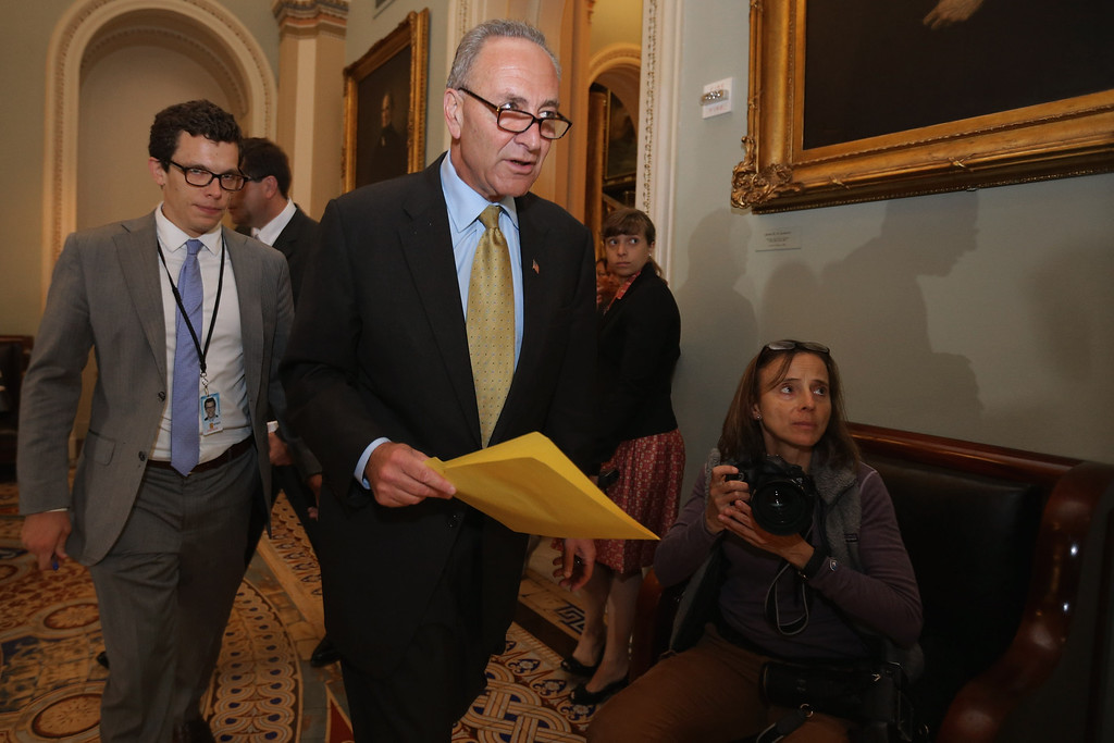 . Sen. Charles Schumer (D-NY) (C) arrives for a Senate Democratic caucus meeting at the U.S. Capitol September 30, 2013 in Washington, DC. (Photo by Chip Somodevilla/Getty Images)