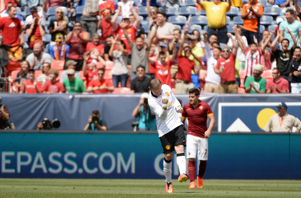 . Wayne Rooney of Manchester United (10), left, celebrates 1st goal of the game against AS Roma at Sports Authority Field at Mile High in Denver, Colorado,  July 26, 2014. (Photo by Hyoung Chang/The Denver Post)
