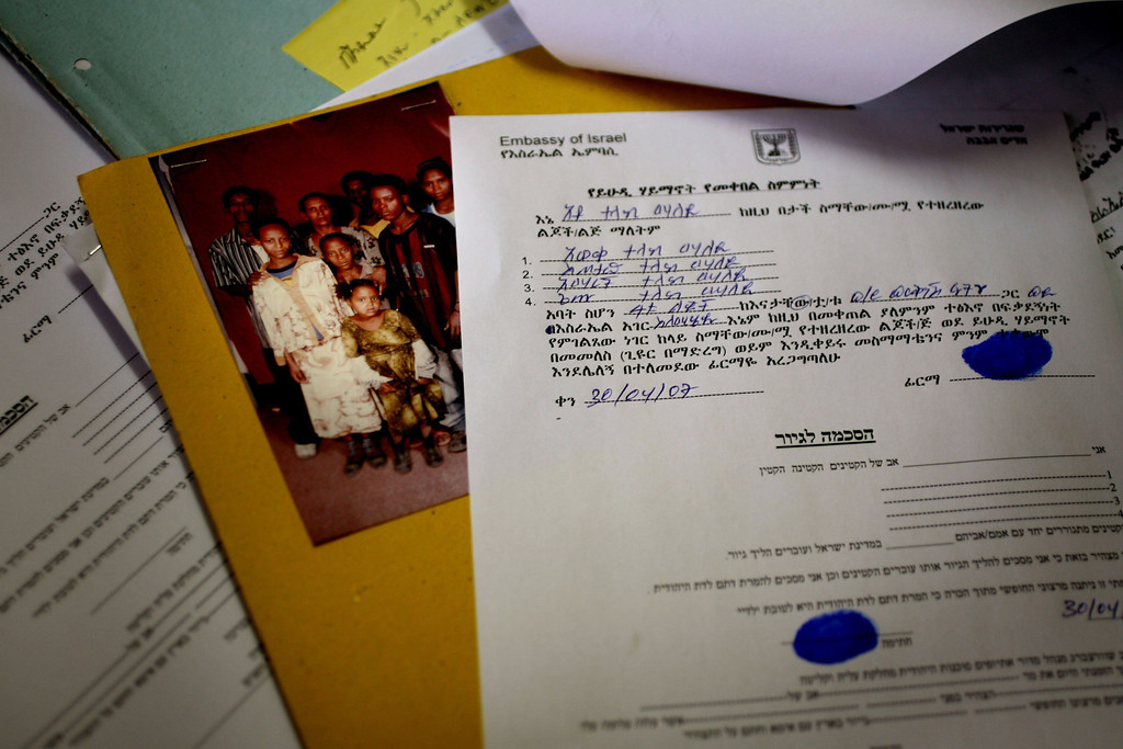 . GONDAR, ETHIOPIA - APRIL 30: Conversion to Judaism documents for the children of a Jewish-Christian couple on a desk in an Israeli government office on April 30, 2007 in Gondar in northern Ethiopia. Some 2,500 Ethiopians of Jewish origin from this province remain in the East African country as Israel slowly brings them over, a few dozen at a time, on commercial flights. Since 1984, more than 73,000 Ethiopian Jews have been settled in Israel. (Photo by Uriel Sinai/Getty Images)