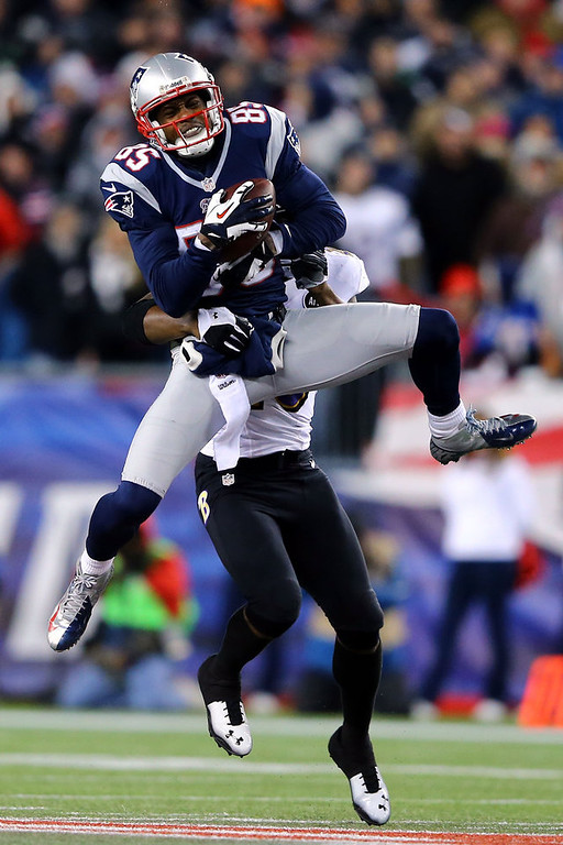 . Brandon Lloyd #85 of the New England Patriots catches a pass over Ed Reed #20 of the Baltimore Ravens during the 2013 AFC Championship game at Gillette Stadium on January 20, 2013 in Foxboro, Massachusetts.  (Photo by Al Bello/Getty Images)