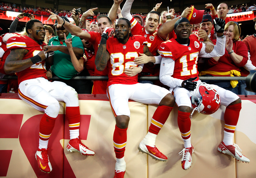 . Cornerback Sean Smith #27, wide receiver Dwayne Bowe #82, and wide receiver Donnie Avery #17 of the Kansas City Chiefs celebrate by jumping into the crowd as the Chiefs defeat the Houston Texans 17-16 to win the game at Arrowhead Stadium on October 20, 2013 in Kansas City, Missouri.  (Photo by Jamie Squire/Getty Images)